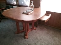 round brown wooden pedestal table Rockford, 61109