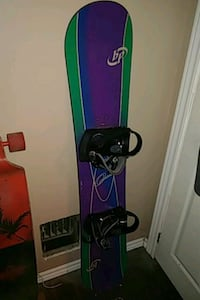 black and blue snowboard with bindings Kitchener, N2G 1M5