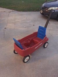 red and blue Radio A flyer pull wagon