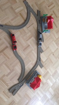 grey and red train tracks toy