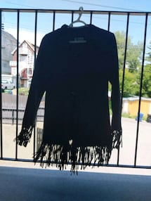 Suede leather black jacket with tassels size xs/small , like new hardl