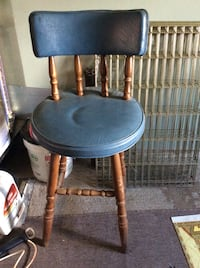 blue leather padded brown wooden windsor chair