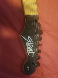 black and brown electric guitar Revere, 02151