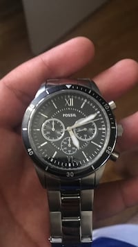 Round black fossil chronograph watch with link bracelet Laval, H7N 1K2