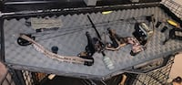 black and brown compound bow in case Baltimore, 21229