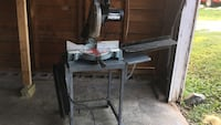 gray and black delta miter saw