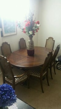 oval brown wooden dining table with 6 chairs set West Des Moines, 50266