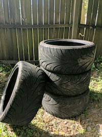 four black vehicle tires with text overlay Pinellas Park, 33782
