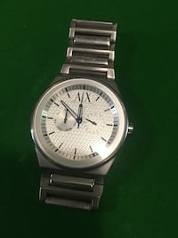 Round white chronograph watch with silver link rbacelet Whitchurch-Stouffville, L4A 0A1