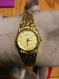 round gold-colored analog watch with link bracelet Hamilton