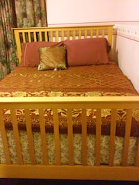 Brown wooden bed frame no mattress Bakersfield