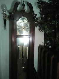 brown wooden framed glass curio cabinet Fayetteville, 28311