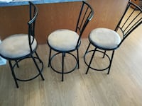 two black metal framed padded chairs Davenport