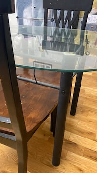 Glass Top dinning table with two wooden chairs