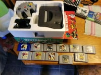 white Nintendo 64 console with controller and game 533 km