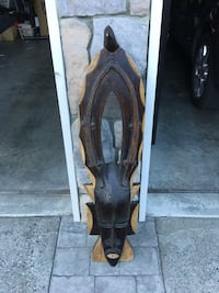 "Large wooden mask. 43"" x 11"" x 6"". Langford, V9B 0L2"
