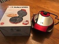 red and white electric kettle with box 39 km