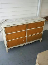 white and brown wooden 3-layer lowboy dresser