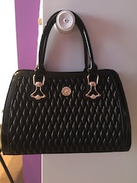 quilted black leather tote bag