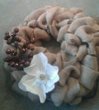 brown mesh wreath with white flower accent