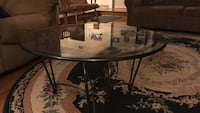 round glass top table with black metal base Clovis, 93619