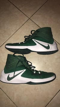 pair of green-and-white Nike basketball shoes Boca Raton, 33428