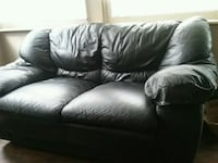 Black leather love seat big tear in arm  Baltimore, 21206