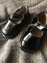 pair of girl's black patent leather mary-jane shoes