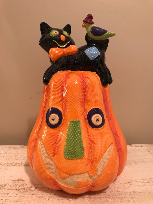"Ceramic Halloween decoration. Measures 14"" tall"