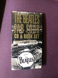 The Beatles Fab Four CD and Book set like new Essex, 21221