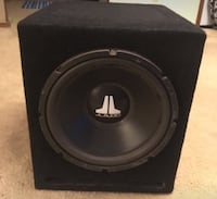 "Black and gray 12"" jl audio subwoofer"