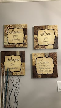 four brown quote printed board decors