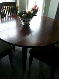 round brown wooden table with two chairs Manassas, 20109