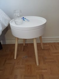 Round white wooden side table with storage