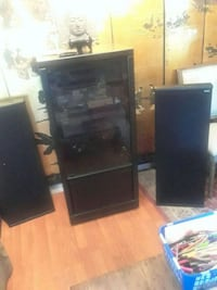 black flat screen TV with black wooden TV stand Cuyahoga Falls, 44221