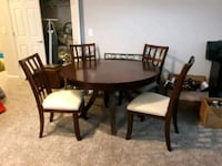 round brown wooden table with four chairs dining set Medford, 11763