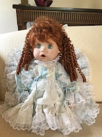 Two Handcrafted Porcelian Dolls
