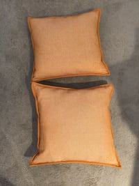 Two 18x18 light orange Ralph Lauren pillows from smoke free home Frederick, 21701