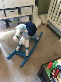 White and blue wooden rocking horse