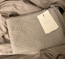 Brand new Ted baker purse with price tag on and dust bag