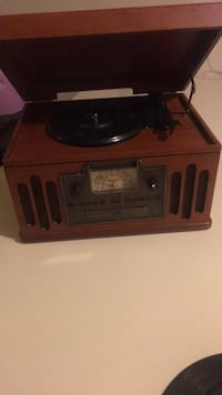 brown and black vinyl player 43 km