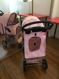 baby's pink and black stroller
