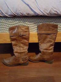 pair of brown leather round-toe side-zip knee-high boots