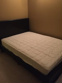 White mattress with black wooden bed frame 525 mi