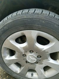 grey Mercedes-Benz hubcap and tire 902 mi