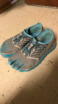 Pair of gray-and-blue running shoes Eau Claire, 54701