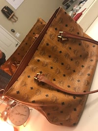 Authentic MCM purse! Some wear but it's beautiful perfect for moms best offer