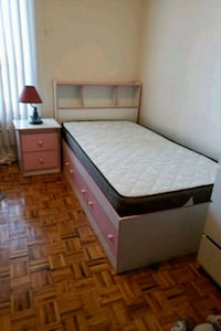 brown wooden bed frame with white mattress Toronto, M8V 3Y9