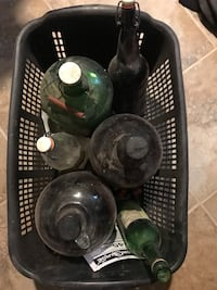 Basket of old glass wine jugs and bottles