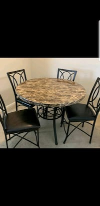 round brown wooden table with four chairs dining set Alexandria, 22312